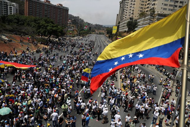 Hundreds of Venezuelans take to the streets in Caracas, Venezuela, on May 1, 2019, a day after members of the opposition clashed with government forces. File Photo by Miguel Gutiérrez/EPA-EFE