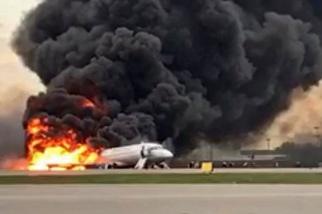 A Sukhoi Superjet 100, operated by Aeroflot, burns at Moscow's Sheremetyevo Airport on Sunday. Photo by Russian Investigative Committee/EPA