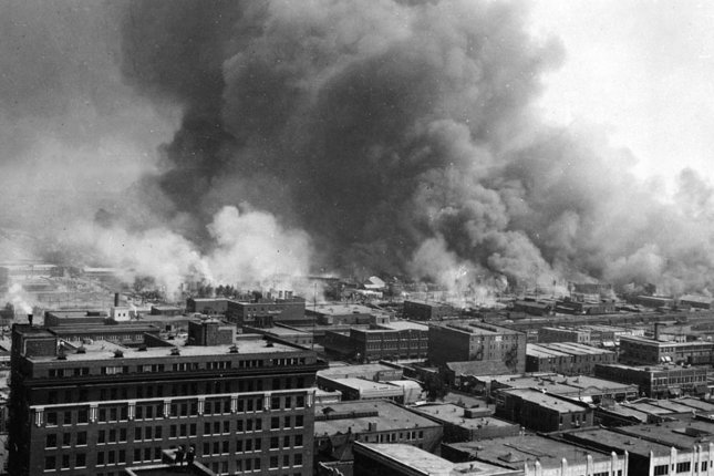 Smoke rises from the Greenwood District on June 1, 1921, after the Tulsa Race Massacre. File Photo courtesy of U.S. Library of Congress