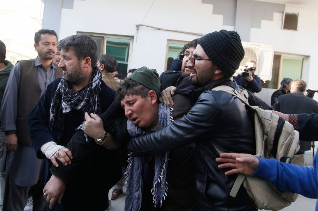 People react after a terror attack at a cultural center in Kabul, Afghanistan on Thursday. Photo by Jawad Jalali/EPA