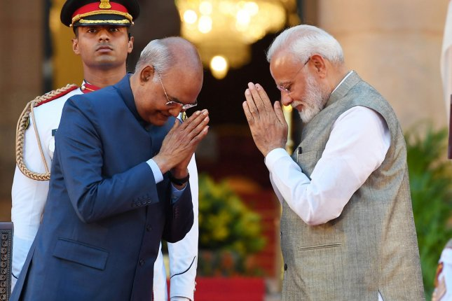 Indian President Ram Nath Kovind (L) congratulates Indian Prime Minister Narendra Modi after administering the oath of office at the presidential palace in New Delhi on Thursday. Photo courtesy of the Press Information Bureau/EPA-EFE