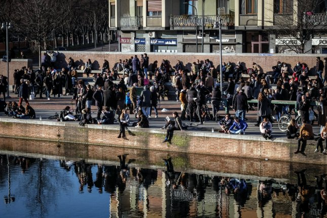 People crowd the Darsena area, in Milan, Italy, on Sunday. The city of Milan and its surrounding Lombardy region will enter the yellow zone with the lowest level of restrictions as Monday. In yellow zones, shops are allowed to open, and restaurants and bars can serve customers until 6 p.m., after which time they can only do takeaway and delivery services. Photo by Matteo Corner/EPA/EFE