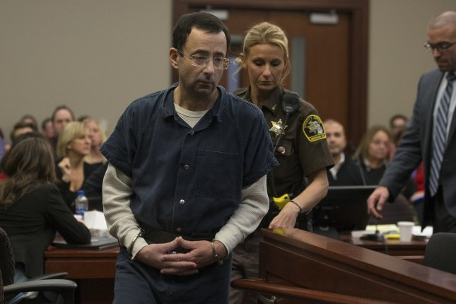 Larry Nassar appears in court in Lansing, Michigan, on January 16. The convicted former USA Gymnastics doctor has been moved from an Arizona prison to a temporary holding facility in Oklahoma. File Photo by Rena Laverty/EPA-EFE