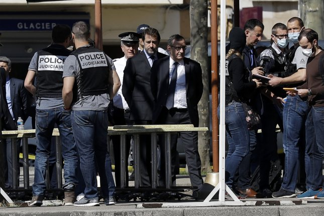 French Interior Minister Christophe Castaner (C) meets with police officers and local authorities at the attack scene in Romans-sur-Isere, France, on Saturday after a man stabbed several people. Photo by Alex Martin/EPA-EFE