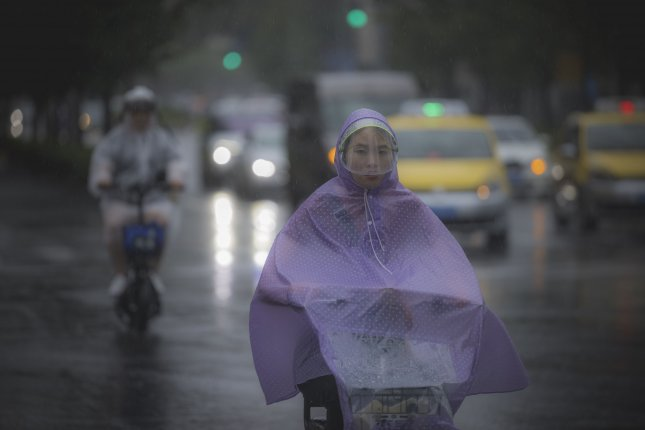 China braced for heavy rainfall as Typhoon In-fa made landfall Sunday afternoon, while portions of the country remain reeling from record flooding. Photo by Alex Plavevski/EPA-EFE