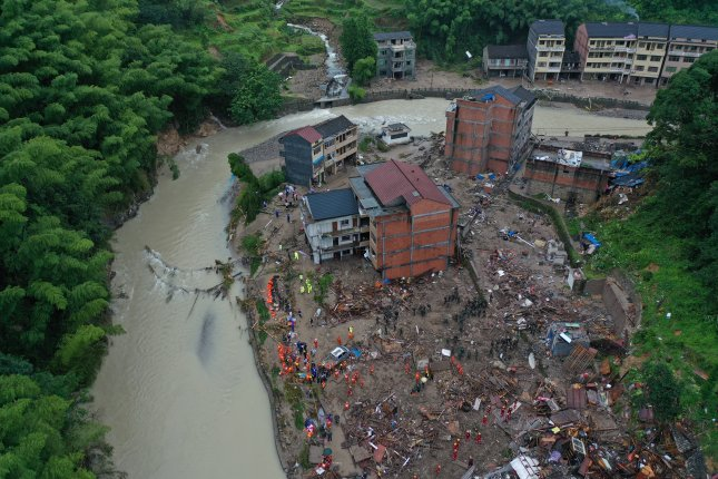 Typhoon Lekima caused a landslide beside a river in Yongjia county in east China's Zhejiang province in China on Saturday. Photo by EPA