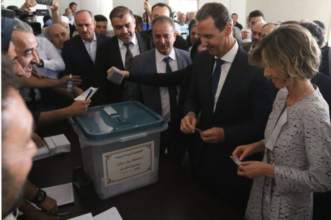 Syrian President Bashar al-Assad and his wife, Asma, cast their votes in the presidential election at a polling station near Damascus, Syria, on May 26. Bashar al-Assad was elected to a fourth term, spurring speculation that Syria may once again play a role in stabilizing Lebanon. Photo by Youssef Badawi/EPA-EFE