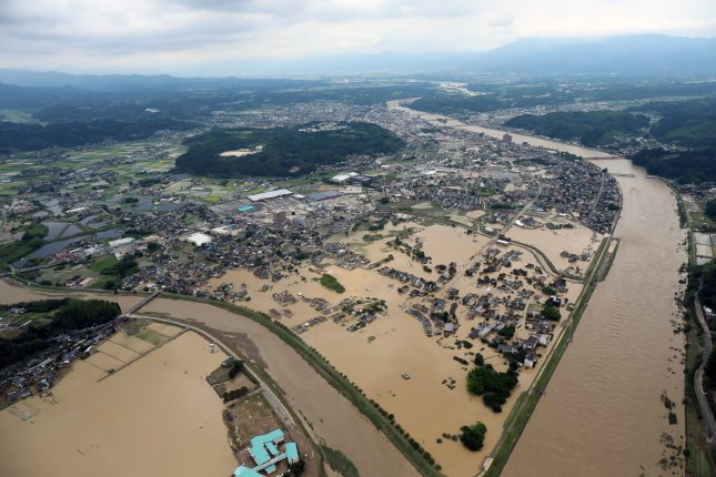 An aerial view shows floods in Hitoyoshi, Kumamoto prefecture, southwestern Japan, on Saturday. Photo courtesy of Jiji Press/EPA-EFE
