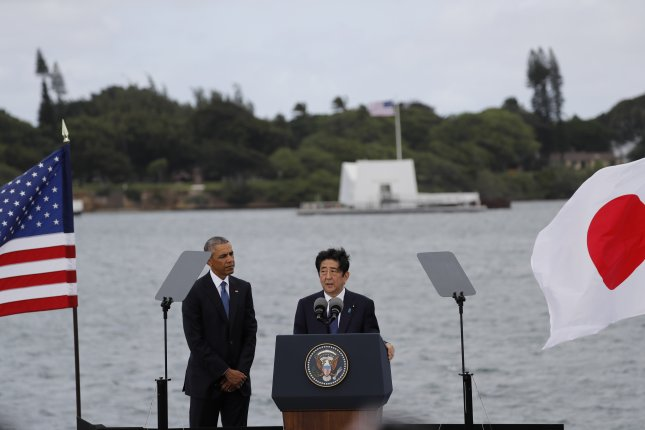 President Barack Obama (L) and Japanese Prime Minister Shinzo Abe (R) hold a joint press conference following their visit to the USS Arizona Memorial (in background) in Pearl Harbor in Honolulu, Hawaii on Tuesday, 75 years after Japan's attack on Hawaii in 1941. Abe is the first Japanese prime minister to visit the Arizona Memorial and the fourth to visit Pear Harbor after World War II. Photo by Bruce Omori/European Pressphoto Agency