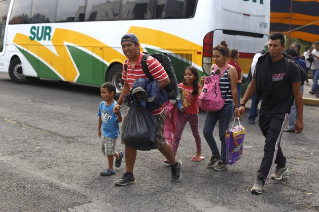 About 200 migrants from throughout Central America reached the U.S.-Mexico border Sunday, in search of asylum. Photo by Francisco Guasco/EPA