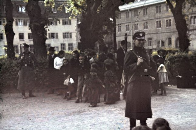 German troops round up Romany for deportation in May 1940. File Photo courtesy of the German Federal Archives