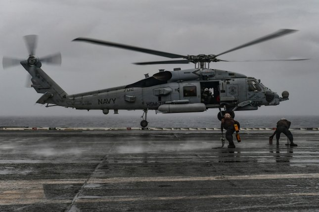"""An MH-60R Seahawk helicopter, assigned to the """"Proud Warriors"""" of Helicopter Maritime Strike Squadron 72, prepares to land aboard the Nimitz-class aircraft carrier USS Harry S. Truman in this 2018 photo. On Thursday Lockheed Martin was awarded$904.8 million to produce and deliver MH-60Rs to the United States and India. Photo byJoseph A.D. Phillips/U.S. Navy"""