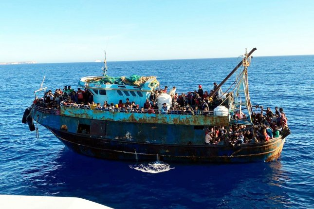 A boat carrying dozens of refugees is seen in the Mediterranean Sea off the coast of Lampedusa, Italy, on May 9. Officials said a vessel carrying dozens of migrants sank off the Greek coast late Thursday. Photo by ANSA/EPA-EFE