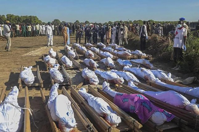 The bodies of Nigerian farm workers slain in a suspected Boko Haram terrorist attack await burial in late November. Photo by EPA-EFE
