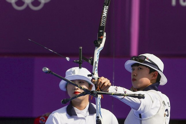 Politicians in South Korea are defending Korean Olympian and archer An San (R) after anonymous comments attacked her for her style of hair. File Photo by Diego Azubel/EPA-EFE