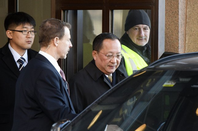 North Korean Foreign Minister Ri Yong Ho, second from right, was seen at Beijing's international airport late Thursday. File Photo by Vilhelm Stokstad/EPA-EFE