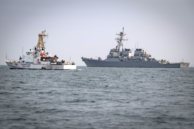 The Arleigh Burke-class guided-missile destroyer USS Donald Cook sails alongside a Georgian coast guard ship in the Black Sea, Jan. 25, 2019. Donald Cook, forward-deployed to Rota, Spain, is on its eighth patrol in the U.S. 6th Fleet area of operations in support of U.S. national security interests in Europe and Africa. Photo by Mass Communication Specialist 2nd Class Ford Williams/U.S. Navy