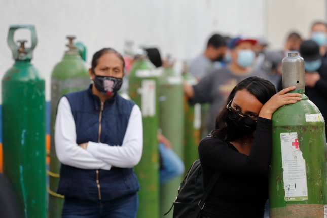 People wait for their turn to fill oxygen tanks in Guadalajara, Jalisco, Mexico, on Tuesday. Photo by Francisco Guasco/EPA-EFE