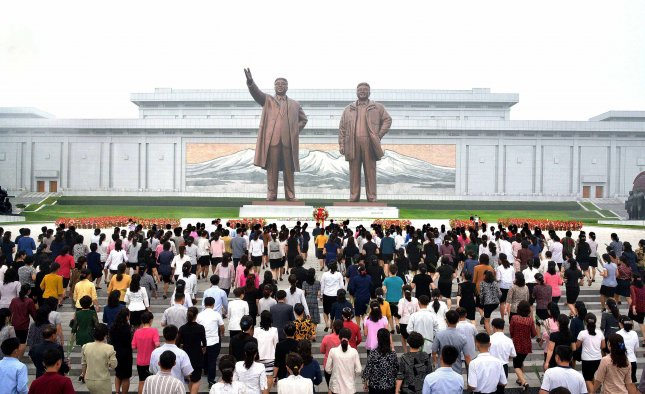 North Koreans marked the sixth anniversary of former leader Kim Jong Il's death on Sunday at Pyongyang's Mansu Hill. File Photo by EPA-EFE