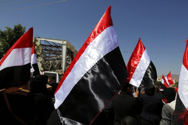 Yemenis hold national flags during a protest rally in solidarity and honor of the dozens of victims of the Saudi-led airstrikes that hit a funeral hall on Oct. 8. The attacks killed 140 people and injured more than 500 others and was based on bad intelligence, officials ultimately said. Tuesday, news reports said the U.S. government has halted some arms sales to Riyadh out of concern for mounting civilian deaths in Yemen. File Photo by Yahya Arhab/European Pressphoto Agency