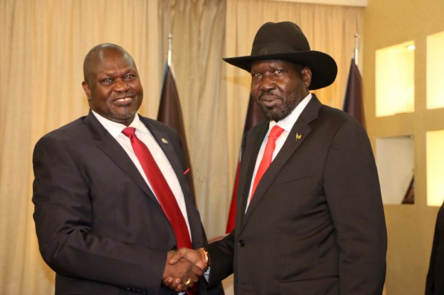South Sudanese President Salva Kiir (R) meets with former rebel leader Riek Machar (L) in Juba, South Sudan, on October 19. File Photo courtesy of STR/EPA-EFE