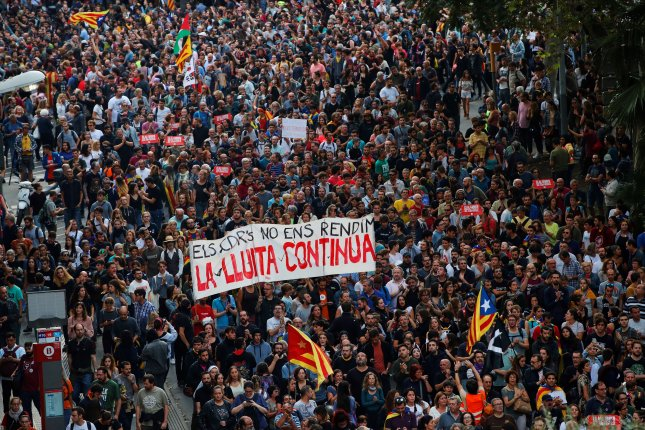 Thousands of people gather at Urquinaona square in Barcelona, Spain, on Saturday to protest against the Supreme Court's recent prison sentence against nine Catalan pro-independence leaders. Photo by Enric Fontcuberta/EPA-EFE