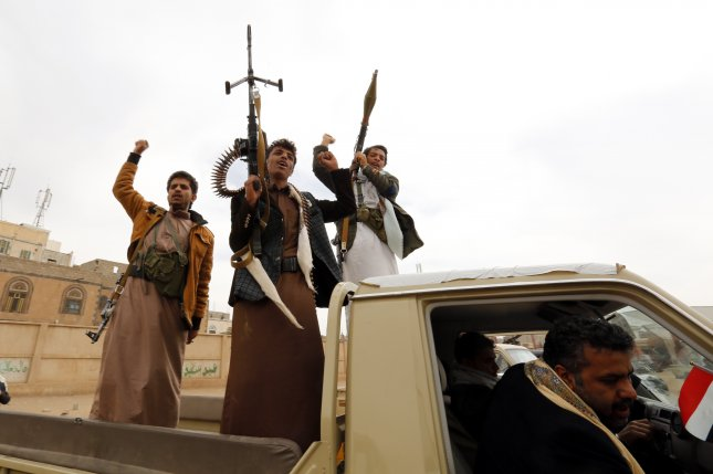 Houthi supporters shout and brandish weapons during an anti-Saudi gathering to mobilize more fighters into several battlefronts, in Sana'a, Yemen on November 10. File Photo by Yahya Arhad/EPA
