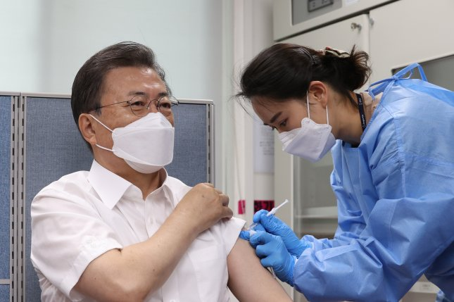 South Korean President Moon Jae-in (L) receives a shot of AstraZeneca's COVID-19 vaccine at a public health facility in Seoul in March. File Photo by Yonhap/EPA-EFE