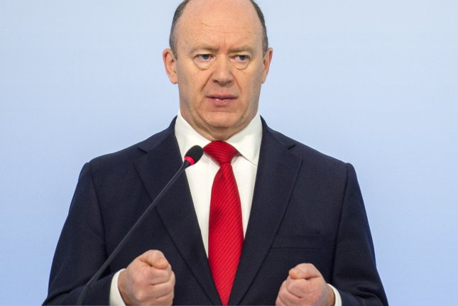Deutsche Bank CEO John Cryan speaks during the annual news conference in Frankfurt, Germany, on Thursday. Deutsche Bank reported a net loss of $1.5 billion for 2016. Photo by Torsten Silz/EPA