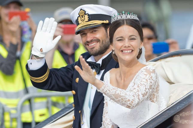 Prince Carl Philip (L) and Princess Sofia on their wedding day on June 13, 2015. File Photo by Stefan Holm/Shutterstock