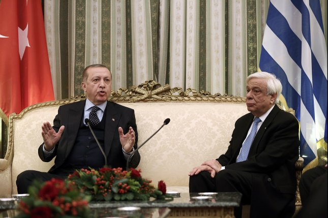 Turkish President Recep Tayyip Erdogan (L) and Greek President Prokopis Pavlopoulos appear during a meeting Thursday at the Presidential Mansion in Athens. Photo by Simela Pantzartzi/pool/EPA