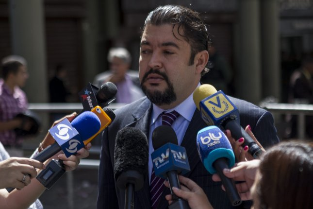 Roberto Marrero, chief of staff of Venezuela's National Assembly and interim leader Juan Guaido, was kidnapped early Thursday by government security agents, Guaido said. In this, image Marrero speaks to the media at main doors of Palace of Justice in Caracas in June 2014. At the time, he was the defense of opposition leader Leopoldo Lopez. File Photo by Santi Donaire/EPA