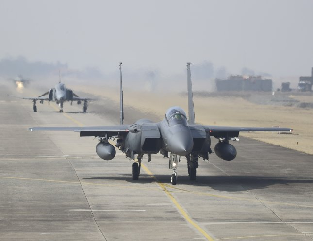 South Korean fighter jets, including F-15Ks and KF-16s, were scrambled Tuesday in response to Russian and Chinese military aircraft entering South Korean airspace. Photo by Yonhap News Service/UPI