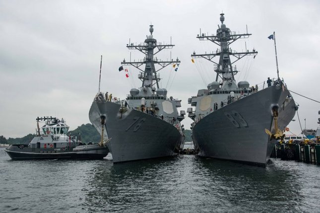 The Arleigh Burke-class guided-missile destroyers USS Higgins, left, and USS Howard arrive Monday at Commander, Fleet Activities Yokosuka in Japan. Photo by Ryo Isobe/U.S. Navy photo by Ryo Isobe