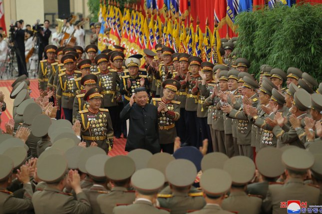 North Korean leader Kim Jong Un (C) greets military personnel during the first-ever workshop of North Korean military commanders last week. File Photo by KCNA/EPA-EFE