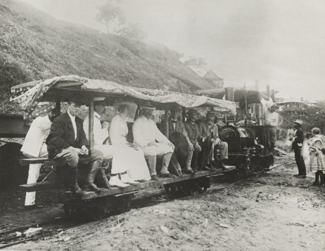 President Theodore Roosevelt and his wife Edith, both dressed in white, seated on a flag draped railroad tram during their tour of the Panama Canal Zone in 1906. File Photo by Library of Congress/UPI