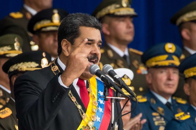 Venezuelan President Nicolas Maduro (c) participates in a televised event in Caracas, Venezuela, on Saturday. His speech was cut short after drones detonated near where he was speaking, unharming the president but injuring seven soldiers. Photo by Miguel Gutierrez/EPA-EFE