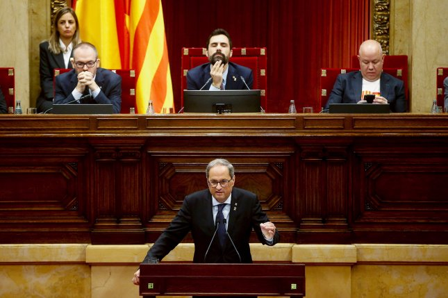 Catalan President Quim Torra (C), delivers a speech in front of Parliament Speaker Roger Torrent (C, behind) during a plenary session at the regional chamber, in Barcelona, Catalonia, Spain, on Thursday. Photo by Quique Garcia/EPA-EFE
