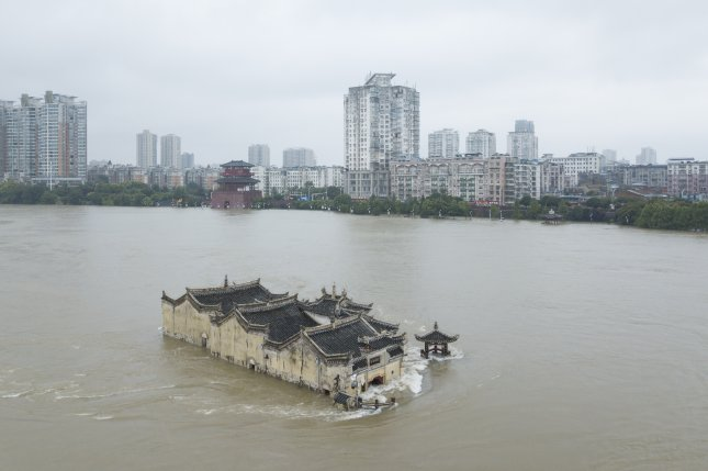 An aerial view of the Guanyin Temple in Hubei Province in the middle of the flooded Yangtze River in Ezhou, China on Sunday. The temple was first built in 1345 and was partly submerged under the latest round of flooding last week. Photo by Peng Nian/EPA-EFE