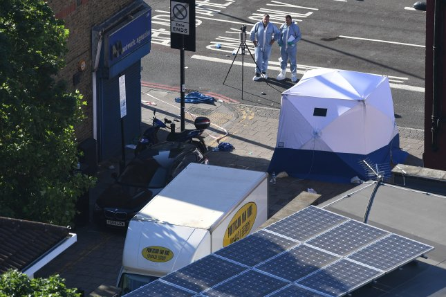 dc0c5de76d7462 Forensics experts on Monday stand next to a van used to plow into  pedestrians near Finsbury Park in north London