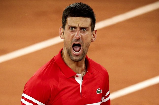 Novak Djokovic of Serbia reacts after winning his quarterfinal match against Matteo Berrettini of Italy on Wednesday at the French Open tennis tournament at Roland Garros in Paris. Photo by Yoan Valat/EPA-EFE