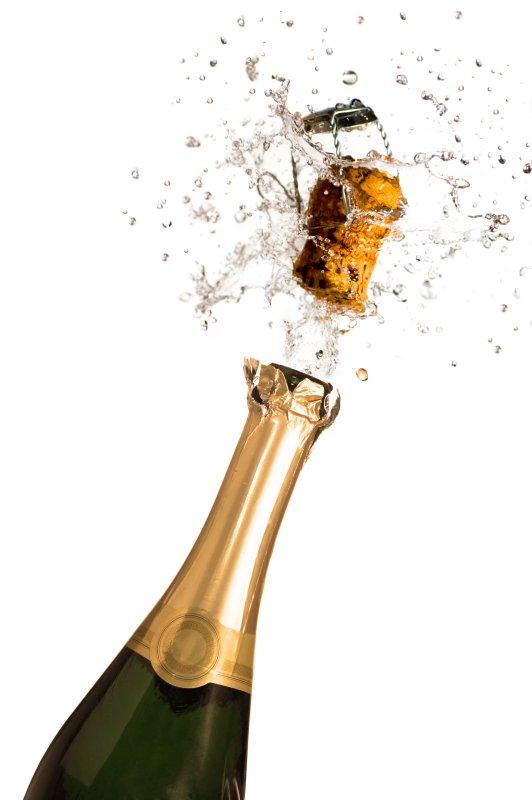 Extreme close-up of explosion of champagne bottle cork (UPI/Shutterstock)