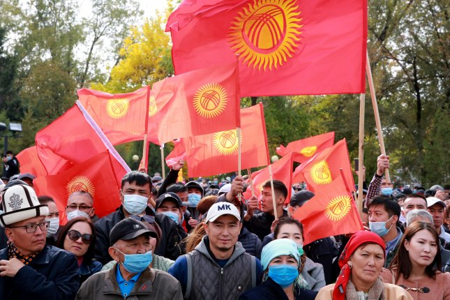 Clashes in Kyrgyzstan as president says he's ready to quit