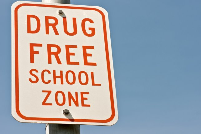 A Drug Free School Zone sign outside a school. Photo by Sue Smith/Shutterstock.com