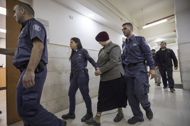 Accused pedophile Malka Leifer (C) arrives at Jerusalem District court for a hearing on February 27, 2018. File Photo by Atef Safadi/EPA-EFE