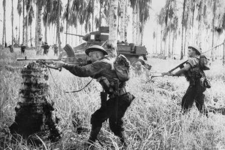 Australian-manned M3 General Stuart tanks attack Japanese pillboxes in the final assault on Buna, Papua New Guinea, on January 2, 1943. On January 22, 1943, U.S. and Australian troops took New Guinea in the first land victory over the Japanese in World War II. File Photo by George Silk/Australian government