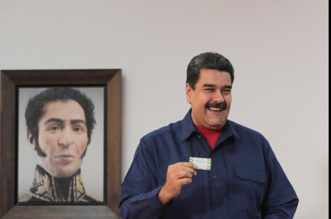 Venezuela calls early election, Maduro to seek second term
