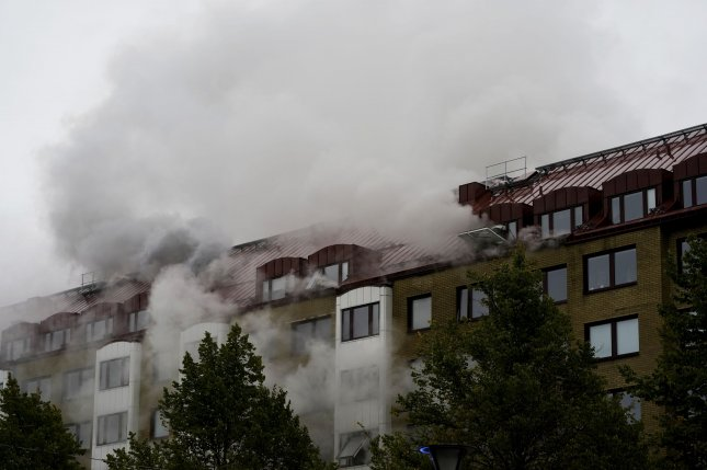 Smoke rises from an apartment building in Gothenburg, Sweden, on Tuesday after an explosion. Photo by Bjorn Larsson Rosv/EPA-EFE
