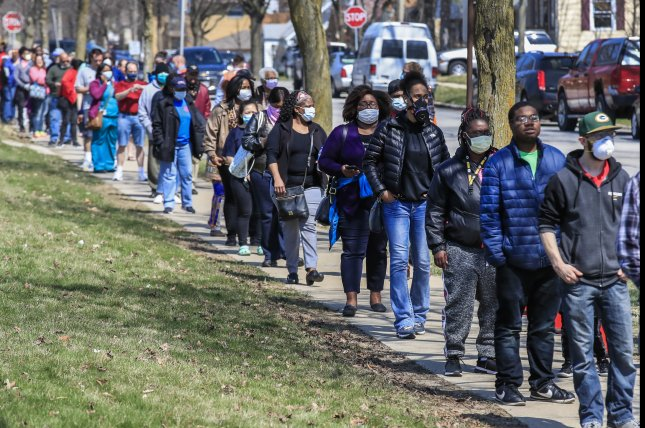 Voters wait in line to cast their ballots in the Wisconsin presidential primary election at Marshall High School in Milwaukee on April 7. Photo by Tannen Maury/EPA-EFE