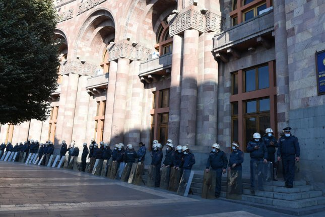 Police guard a government buildingin Yerevan, Armenia, on Tuesday after protesters gathered to oppose a cease-fire agreement to end fighting in the Nagorno-Karabakh region. Photo by Lusi Sargsyan/EPA-EFE
